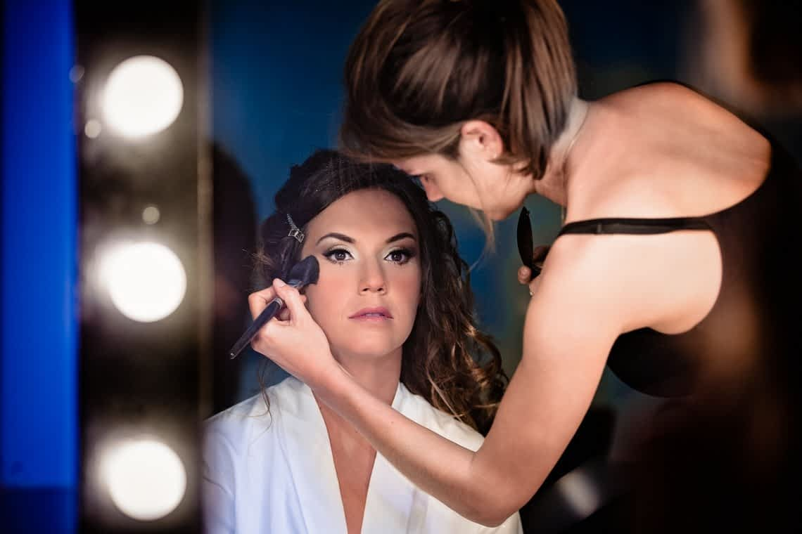 The beautiful bridem getting her final touches of makeup.