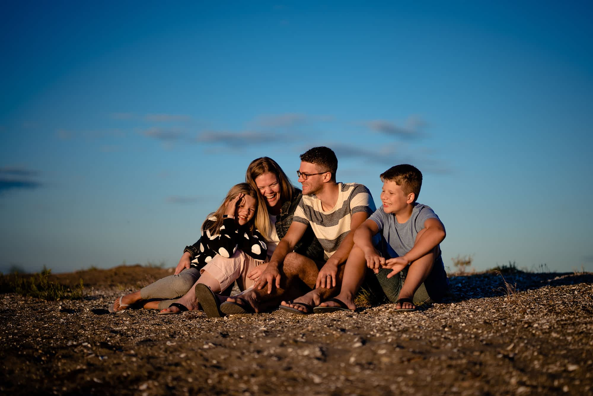 Family photoshoot on the beach by Paragon Expressions